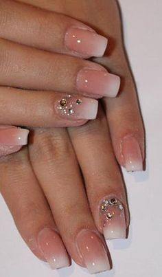 Love this simple nail design with rhinestones for a touch of elegance