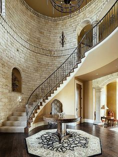 Make a grand entrance into the foyer with these curved castle-like stairs.