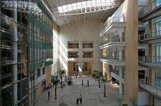 The Hindustan Unilever campus in Andheri, Mumbai, designed by Kapadia Associates. The campus creates a cohesive and vibrant work environment, with generous access to natural light and views.  The heart of the campus is a dramatic linear atrium space.  All offices and laboratories open out onto the street, with public functions on the ground level and breakout spaces on the upper levels. #greenbuildings #architecture #urbanarchitecture