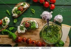 Grilled toasts with mozzarella, tomatoes and homemade pesto, vegetable on skewers