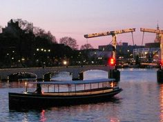 Canal Boat in front of the Skinny Bridge Amsterdam  For information: www.deavanti.nl