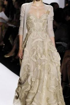 Oscar de la Renta gown with a cardigan? my kind of style.