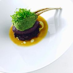The green rack a part of @froot_tree_restaurant opening menu parsley crusted lamb rack with a caramelised red onion and red cabbage mash /with red cabbage slaw @chefjasonhoward