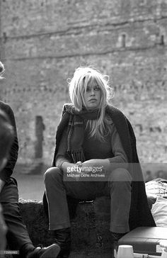 French actress Brigitte Bardot takes a break while filming a scene from the movie 'Two Weeks in September' (aka À Coeur Joie) on location in Scotland in 1967.