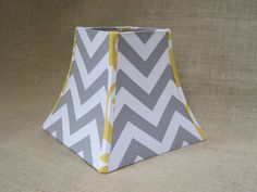 this lamp shade with a grey chevron pattern and citron patterned trim! I love this!