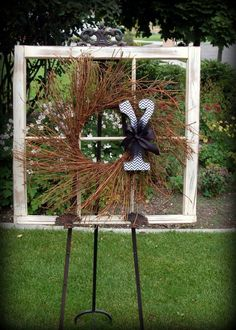 Like the idea of having a old window on a easel with a wreath