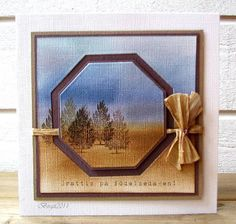 By Birgit Edblom (Biggan at Splitcoaststampers). The image was sponged and stamped. Then she die-cut two octagons from the center, leaving a negative octagon frame. Image is mounted on brown cardstock, which shows through the cut-out octagon. The smaller octagon is mounted on the same brown with a narrow border & is popped up with dimensionals. The ribbons threads behind the smaller octagon. Great idea!