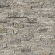 From MSI Stone  Have Sample - Primarily Gray with some beige undertones.  Medium Gray. Split stone front edges. Ledger Panels | Silver Travertine | Hardscape