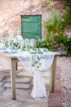 Classic Elegance Bignor Park Fine Art Photoshoot - Always Andri soft lace and foliage table runner in rustic setting