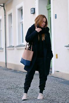 Desi is wearing: Céline Tote Bag, light pink sneakers  - teetharejade.com