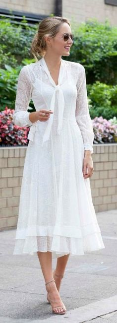 white lace midi dress with neck tie, bishop sleeves, ruffle detail + nude ankle strap heeled sandals and messy bun hairstyle {rebecca taylor, steve madden, bridal shower} #anklestrapsheelswithdress