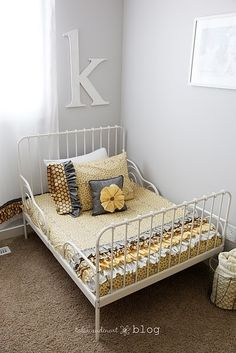 Love this toddler bed. Love the yellow-grey (Wendy's nursery is in these colors too). by katharine