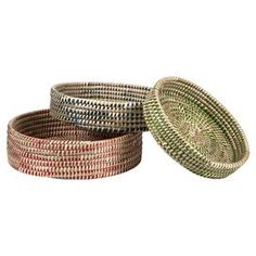 """Bring a touch of organic appeal to your entryway console or living room coffee table with this delightful tray set, artfully woven of seagrass and palm leaf.     Product: Small, medium and large trayConstruction Material: Seagrass and palm leafColor: Natural, red, blue and greenFeatures:  Eco-friendlyWoven designMade in BangladeshDimensions: Small: 6"""" H x 32"""" DiameterMedium: 8"""" H x 36"""" DiameterLarge: 10"""" H x 40"""" Diameter"""