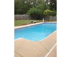 A spacious covered patio leads way to the in-ground salt water pool and large fenced yard.
