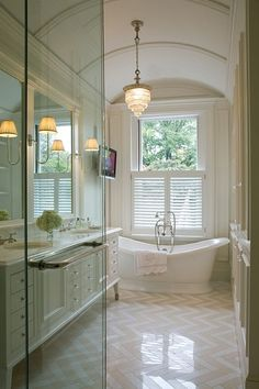 Lots of white, light, and airy with touches of sparkle and glass. Love the white cabinets and built in mirror