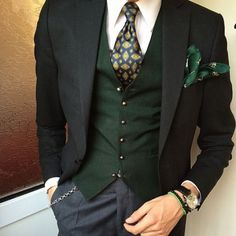 I like this combination. It's different and green especially used like this is rare sight in men's suit style but it works.