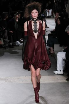 Victorian hair, gothic silhouettes and pastel petal dresses – for McQueen AW15, Sarah Burton is bringing romance back.