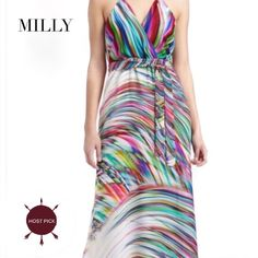 """🎉HP🎉 Milly Silk Halter Maxi Dress Take on the summer with the vibrant swirls on this fabulous maxi dress by Milly. This maxi comes with a printed georgette, halter surplice neck line, a self-tie waist and a skirt that falls to the foot with a right side slit. This Milly dress boasts a rainbow of hues to show off a range of skin tones. Size: 6 Approx. Measurements: Bust 33-36"""" Waist 28"""". Material: Silk Condition: Pristine-NWOT/NW Milly  Dresses Maxi"""
