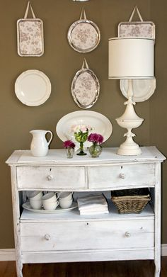 Take out one drawer and a dresser becomes a side board.  I like the vintage silver trays hanging on ribbons.