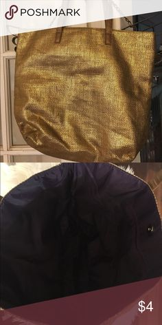 Gold tote bag Excellent condition, woven tote bag, inside is purple with snap closer and one inside zipper pocket.  Great size, nice for the beach, or pool. Walmart Bags Totes