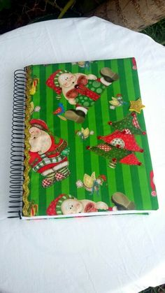 Caderno de assinaturas,decorado com motivo de Natal.