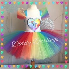 Rainbow Dash Tutu Dress.. Glitter. My Little Pony Dress. Special Occasion. Beautiful & lovingly handmade. All characters and colours available Price varies on size, starting from £25. Please message us for more info. Find us on Facebook www.facebook.com/DiddyDarlings1 or our website www.diddydarlings.co.uk
