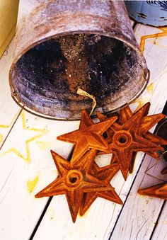 Rusty Cast Iron Stars...with old metal bucket...