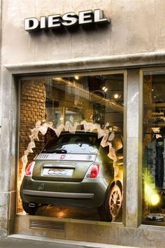Window Display ~Diesel, the rock kids of fashion, display the rebellious appeal of their brand by driving a car through the window.