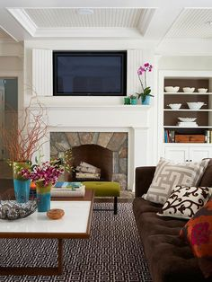 Media Mantel  Flat-panel TVs often find a place above a fireplace. But the look can disrupt the fireplaces decorative facade. Reclaim your fireplaces appearance by recessing the unit into the wall behind the fireplace and enclosing it with bifold doors. Here, the doors are clad in beaded-board to match the coffered ceiling - someone hinged art to hid the tv!