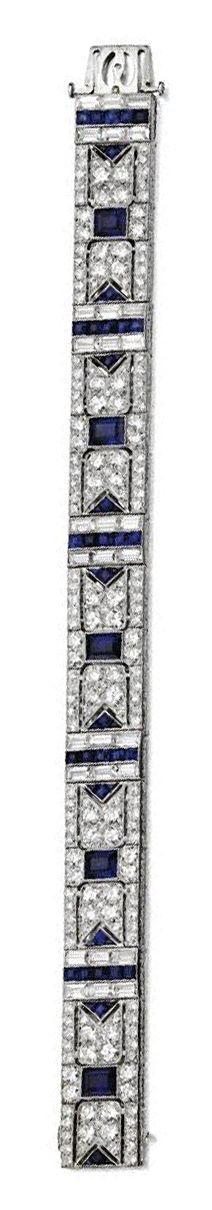 SAPPHIRE AND DIAMOND BRACELET, BLACK, STARR & FROST, CIRCA 1920.  The articulated band decorated in a geometric design with 5 emerald-cut sapphires weighing approximately 13.00 carats and bands of  57 calibré-cut sapphires, completed by 180 old European-cut and single-cut diamonds weighing approximately 9.00 carats and 30 baguette diamonds weighing approximately 4.00 carats, mounted in platinum, length 7 inches, signed B.S. & F.