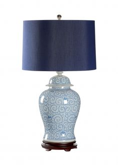 """This lovely lamp is made with porcelain and features a hand painted blue and white design. The lamp is topped off with a blue shade. The lamp measures 37""""H and the shade measures 19"""" in diameter on th"""