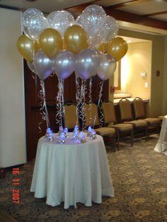 Centros de mesa, con luz en la base, globos aperlados. Globos Amer: www.regalosamer.com.mx
