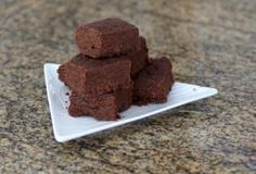 This easy microwave chocolate fudge is made with confectioners sugar and vanilla, cocoa, milk, butter, and chopped pecans.
