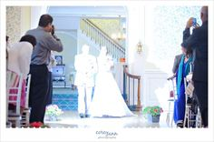 Why to limit the number of photographers.  Perhaps guests shouldn't take photos during the ceremony
