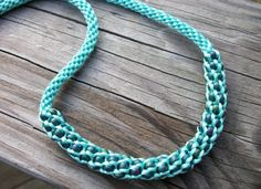 Aquamarine Beaded Kumihimo Necklace - like the look of the larger beads woven into the center of the braid