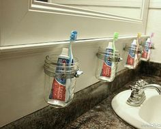Mason Jar Bathroom Storage :: Hometalk Perhaps on the cabinet door to keep dust off of them