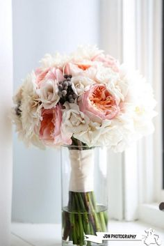 Weddbook is a content discovery engine mostly specialized on wedding concept. You can collect images, videos or articles you discovered  organize them, add your own ideas to your collections and share with other people - The bride will carry white hydrangea, peachy-pink Juliet garden roses, blush spray roses and white spray roses wrapped in ivory ribbon with the stems showing and a rhinestone accent. No silver berries like in this photo.