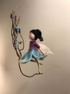 This air, flying Flower fairy decorate any corner of your house. It made of wool in two colors: purple and turquoise. The height of the fairy is about cm). Wool Dolls, Felt Dolls, Easy Felt Crafts, Fairy Nursery, Felt Angel, Wool Needle Felting, Felt Fairy, Beautiful Fairies, Flower Fairies