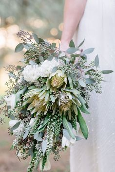 Australian native white and gold sheath wedding bouquet with Eucalyptus, Tulips and Hyacinths | Peggy Saas Photography | See more: http://theweddingplaybook.com/20-beautiful-wedding-bouquets-to-have-and-to-hold/
