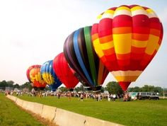 The Coshocton Hot Air Balloon Festival in Cleveland, Ohio. Warmer weather is forecasted for this weekend.  I can only hope to see them flying again. I had so much fun chasing them on Tuesday!