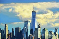 One World Trade Center (Freedom Tower) in shades of later afternoon blue. Prints available in a variety of sizes and formats, framed and unframed. Manhattan Skyline, Lower Manhattan, New York Skyline, Yellow Artwork, One World Trade Center, Blue Prints, White Clouds, First World, Wall Art Decor