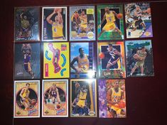 Lot of 14 Los Angeles Lakers cards consisting of rookie cards of Derek Fisher and other cards of Magic Johnson, Eddie Jones, James Worthy, and Nick Van Exel. Nick Van Exel, Ants Marching, Derek Fisher, James Worthy, Nba Sports, Magic Johnson, Los Angeles Lakers, Trading Cards, Badge
