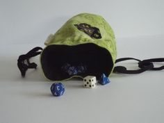 Green and black dice pouch with a D20 design.
