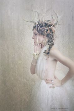 Fine art fashion photography. Tulle dress with antlers and pearls