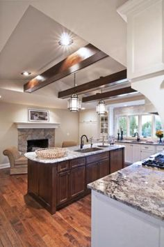 Another view of perfect kitchen with fireplace and sitting area