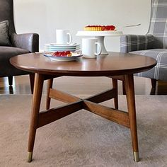 Mid-Century, Transitional Round Coffee Table with Warm Walnut Finish - 3184475. Tapered Legs Capped with Brass Finished Brackets Accent Table. Assembly Required by angelo:HOME
