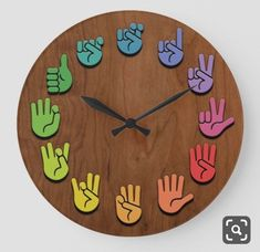 ASL Woodgrain Large Clock ASL sign language hands clock, with hands in color wheel colors, on a woodgrain faux finish background. Sign Language Phrases, Sign Language Alphabet, Learn Sign Language, American Sign Language, Sign Language Colors, Sign Language For Kids, Asl Signs, Deaf Culture, Muslim Culture