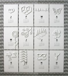 monthly calendar idea using white on white die cuts; NOT PL, but I think a very adaptable idea
