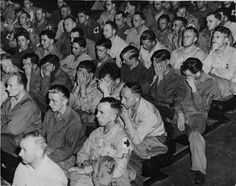 The immediate reaction of German POWs upon being forced by the US Army to watch to the uncensored footage of the concentration camps shot by the US Signal Corps. Not sure if that is guilt over what they participated in or sorrow because they didn't know all that went on in the camps.