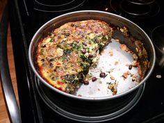 Deep dish garlic onion spinach and black bean quiche with parmesan mozzarella and cheddar cheese